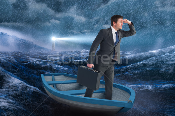 Stock photo: Composite image of businessman in boat