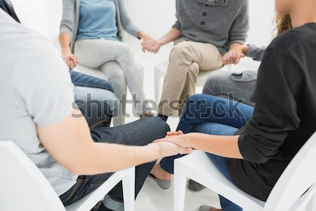 Group therapy in session sitting in a circle Stock photo © wavebreak_media