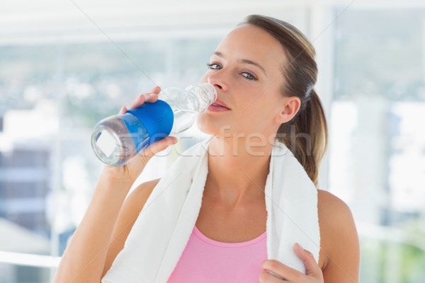 Woman with towel drinking water in gym Stock photo © wavebreak_media
