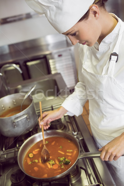 Concentrated female cook preparing food in kitchen Stock photo © wavebreak_media