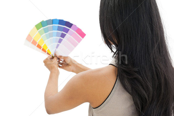Rear view of a woman looking at paint samples Stock photo © wavebreak_media