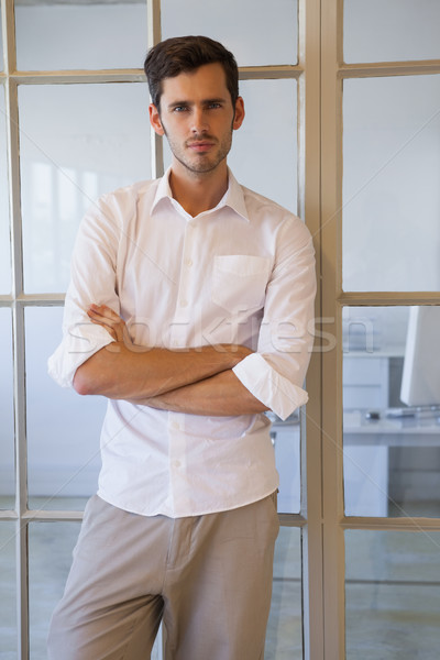 Casual businessman standing with arms crossed Stock photo © wavebreak_media