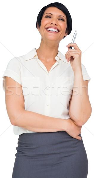 Thoughtful brown haired businesswoman in skirt Stock photo © wavebreak_media