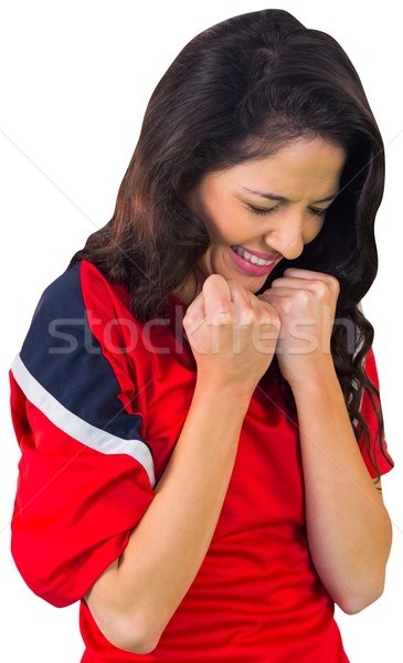 Cheering football fan in red Stock photo © wavebreak_media
