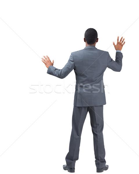 Zakenman permanente handen omhoog witte business pak Stockfoto © wavebreak_media