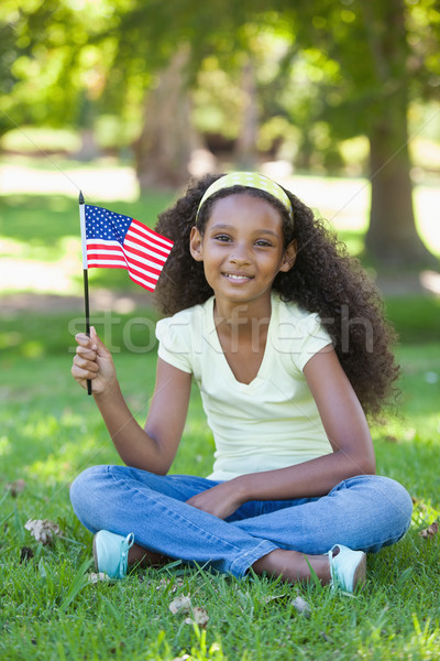 Young girl celebrating independence day in the park Stock photo © wavebreak_media