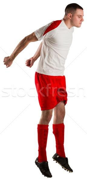 Encajar futbolista saltar hasta blanco fútbol Foto stock © wavebreak_media