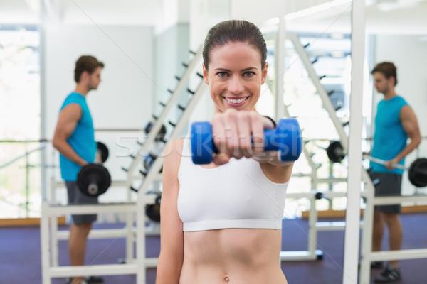 Fitt barna hajú testmozgás kék súlyzók tornaterem Stock fotó © wavebreak_media