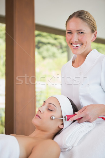 Stock photo: Brunette getting micro dermabrasion with therapist smiling at ca