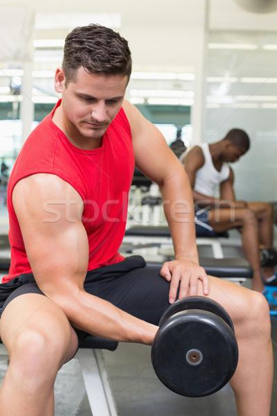 Knap bodybuilder vergadering bank Stockfoto © wavebreak_media