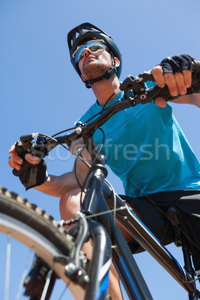 Fit cyclist riding on country trail Stock photo © wavebreak_media