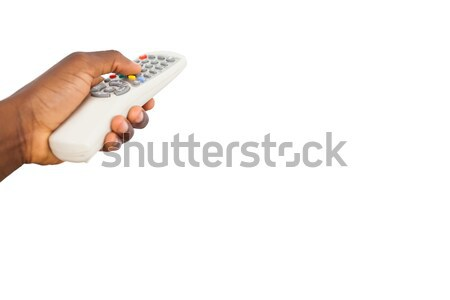Mans hand holding remote control Stock photo © wavebreak_media