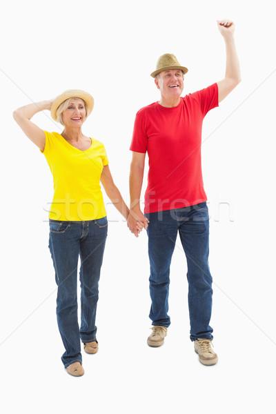 Mature couple walking and holding hands Stock photo © wavebreak_media
