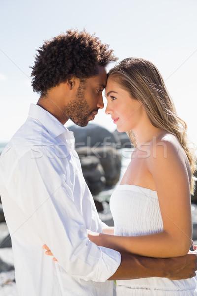 Gorgeous couple embracing by the coast Stock photo © wavebreak_media