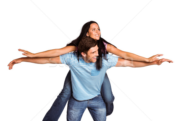 Jonge man vriendin op de rug vrouwelijke glimlachend mannelijke Stockfoto © wavebreak_media