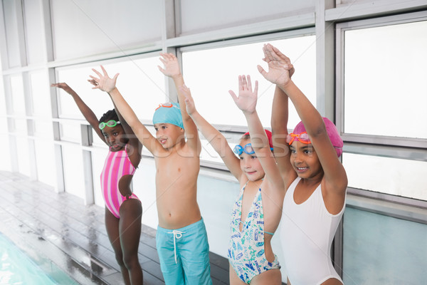 Cute little kids standing poolside with arms up Stock photo © wavebreak_media
