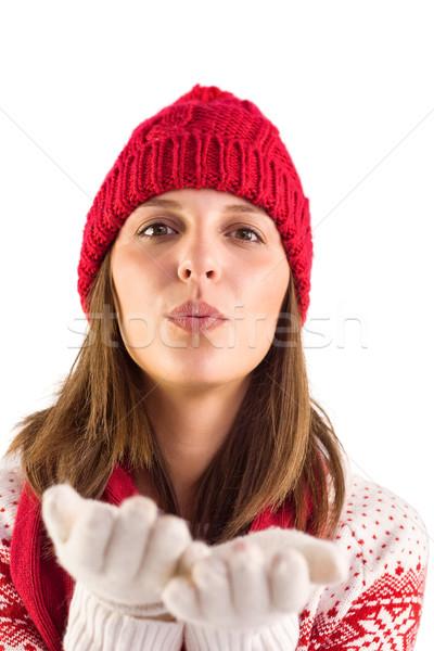Happy brunette blowing over hands Stock photo © wavebreak_media