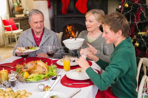Smiling extended family at the christmas dinner table Stock photo © wavebreak_media