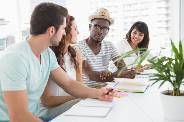 Munkatársak ül jegyzetel együtt iroda megbeszélés Stock fotó © wavebreak_media