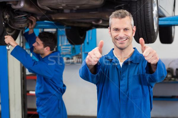 Team of mechanics working together Stock photo © wavebreak_media