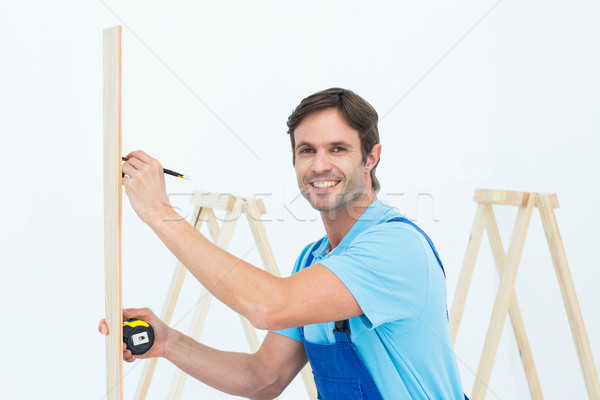 Portrait of carpenter marking on wood Stock photo © wavebreak_media