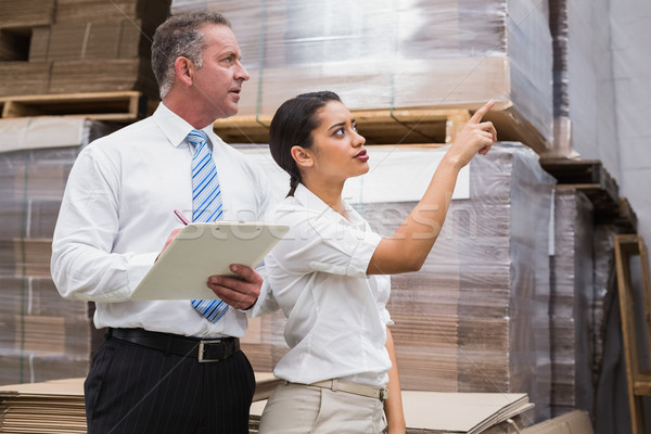Warehouse manager and her boss checking inventory Stock photo © wavebreak_media