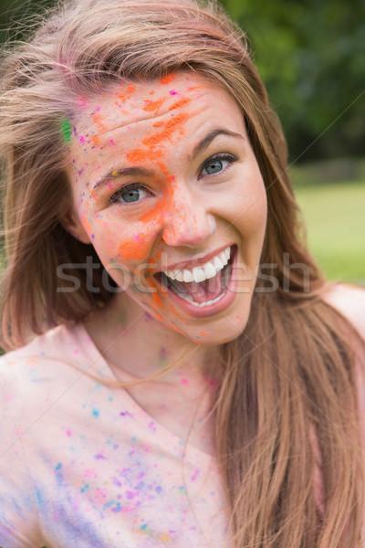 Fiatal nő szórakozás por festék napos idő nő Stock fotó © wavebreak_media