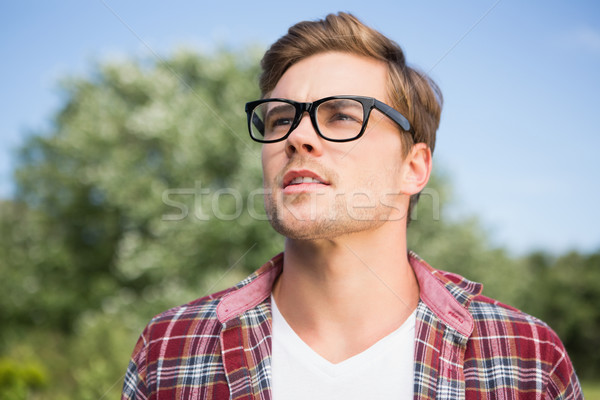 Handsome hipster thinking in the park Stock photo © wavebreak_media