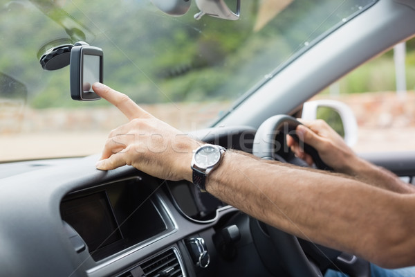 Man using satellite navigation system Stock photo © wavebreak_media