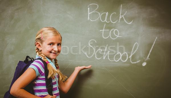 Portrait of cute little girl in classroom Stock photo © wavebreak_media