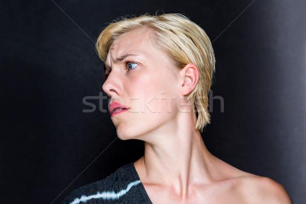 Angstig blonde vrouw zwarte vrouw mooie cute Stockfoto © wavebreak_media