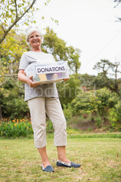 Happy grandmother holding donation box Stock photo © wavebreak_media