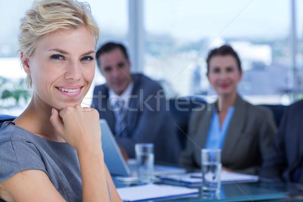Femme d'affaires souriant caméra collègues derrière bureau Photo stock © wavebreak_media