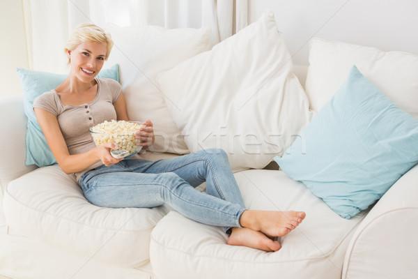 Portre gülen sarışın kadın izlerken tv yeme Stok fotoğraf © wavebreak_media