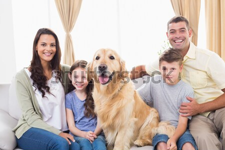 Sorridente irmãs golden retriever tapete casa sala de estar Foto stock © wavebreak_media