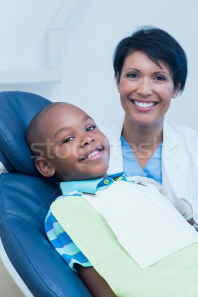 Smiling boy waiting for dental exam  Stock photo © wavebreak_media