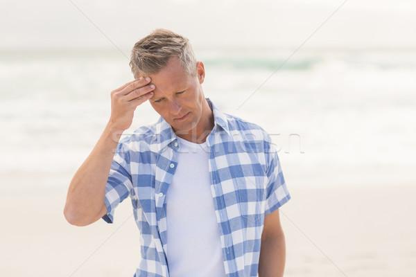 Toevallig man gevoel bezorgd strand vakantie Stockfoto © wavebreak_media