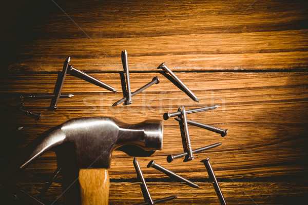 Marteau clous sur table coup studio Photo stock © wavebreak_media