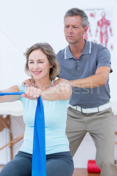 Doctor examining his patient back  Stock photo © wavebreak_media
