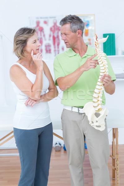 Doctor showing anatomical spine Stock photo © wavebreak_media