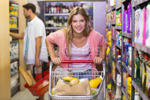 Portrait of smiling pretty blonde woman buying products Stock photo © wavebreak_media
