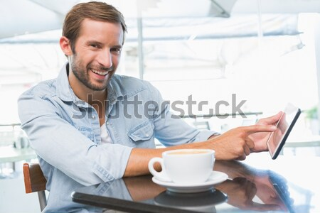 Young happy man holding the newspapers while looking at the came Stock photo © wavebreak_media