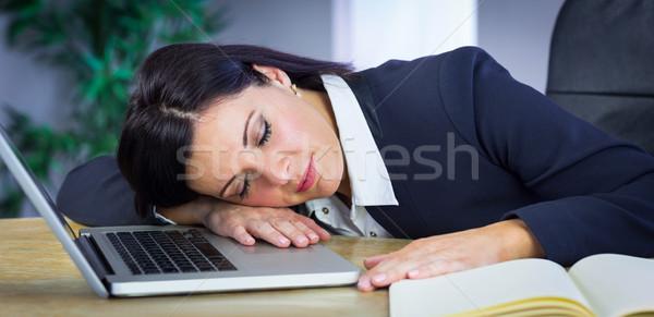 Businesswoman taking a nap on her desk Stock photo © wavebreak_media