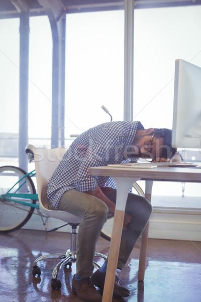 Tired businessman napping in office Stock photo © wavebreak_media