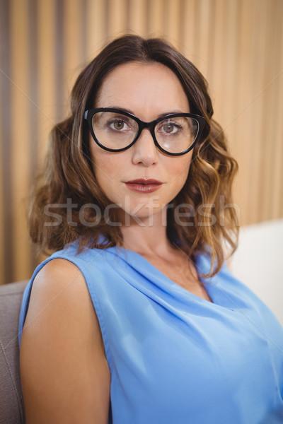 Portret wykonawczej okulary posiedzenia sofa biuro Zdjęcia stock © wavebreak_media