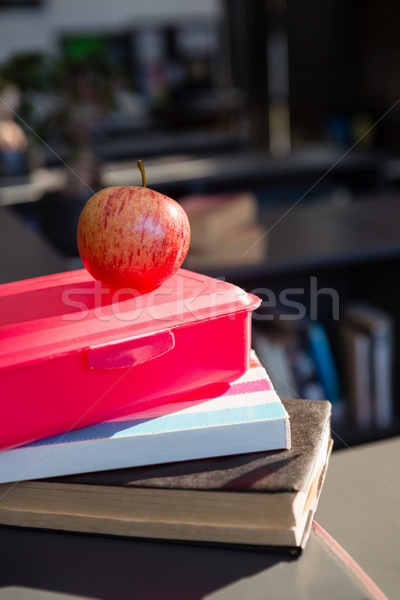 Close up of red apple on tiffin box at library Stock photo © wavebreak_media