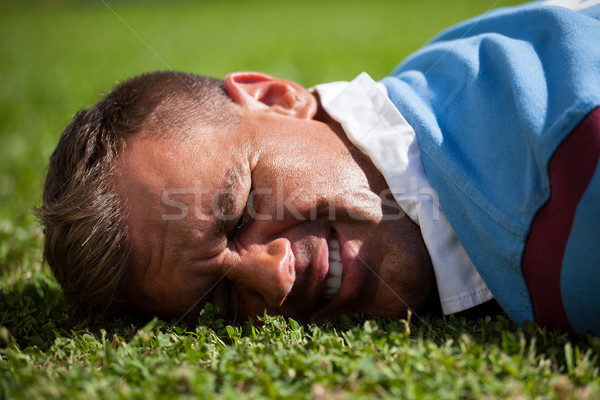 Close up of injured rugby player lying on field Stock photo © wavebreak_media