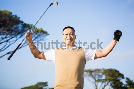 Portrait of happy rugby player holding ball against blue sky Stock photo © wavebreak_media