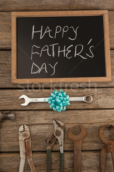 Slate with happy fathers day text and hand tools on table Stock photo © wavebreak_media