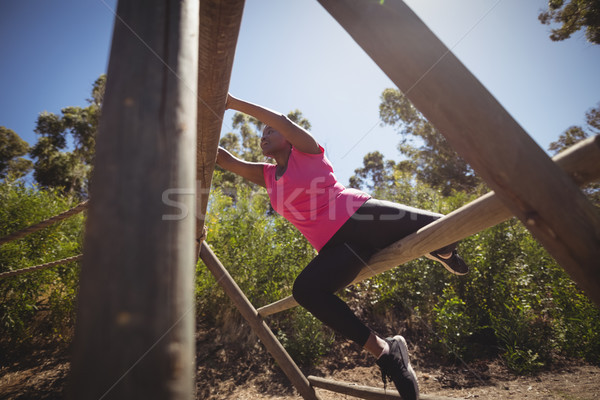 Woman exercising on outdoor equipment during obstacle course Stock photo © wavebreak_media